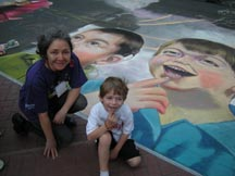 Lilibeth Andre, 2010 Houston Via Colori, detail of an 1,800 square foot mural, photo with the model.