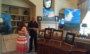 Artist Layne Johnson talks about his art at a recent private reception.